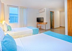 森特纳里欧顶级 MS 酒店 - 卡利 - 睡房