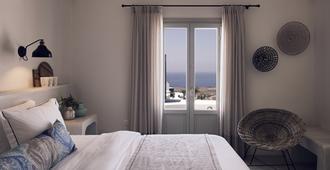 伊亚桑托玛里斯豪华套房和Spa酒店 - 伊亚 - 睡房
