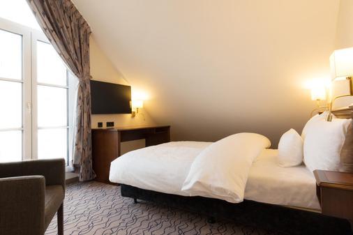 国王都市酒店 - 慕尼黑 - 睡房