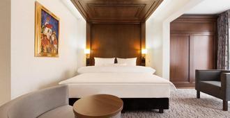 国王城市酒店 - 慕尼黑 - 睡房
