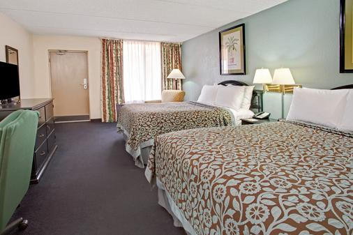 奥兰多机场/佛罗里达购物中心戴斯酒店 - 奥兰多 - 睡房