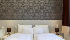 米卡市中心酒店 - 布达佩斯 - 睡房