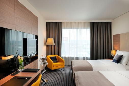 卢比安纳广场丽笙蓝标酒店 - 卢布尔雅那 - 睡房