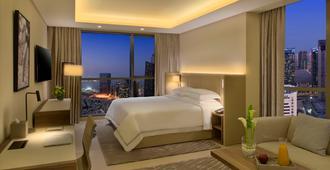 多哈西湾套房酒店 - 多哈 - 睡房