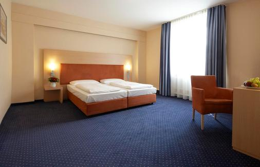 Intercityhotel Stuttgart - 斯图加特 - 睡房