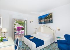 萨沃亚酒店 - 波西塔诺 - 睡房