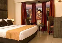希尔顿皇家柯芒拉酒店 - 班加罗尔 - 睡房