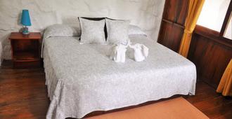 拉瓦之家旅馆 - 阿约拉港 - 睡房