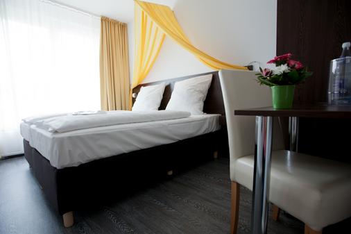 柏林基兹潘森酒店 - 柏林 - 睡房
