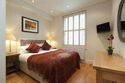伦敦温哥华一室公寓式酒店 - 伦敦 - 睡房