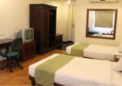 Sandhya Hotel - 海得拉巴 - 睡房