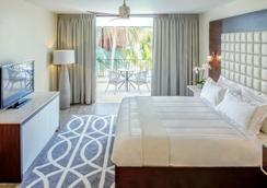 弗洛里斯套房水疗酒店及海滩俱乐部 - 威廉斯塔德 - 睡房