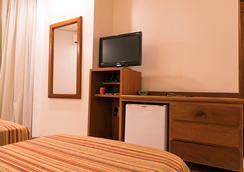 塔曼达雷广场酒店 - 戈亚尼亚 - 客房设施