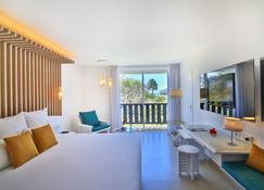 拉克里奥尔海滩水疗酒店 - 戈齐尔 - 睡房