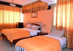 马雷贡酒店 - 瓜亚基尔 - 睡房