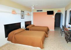 Hotel Playa Bonita - 马萨特兰 - 睡房
