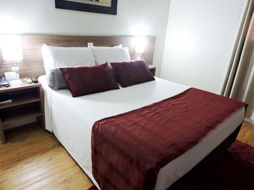 艾克欧斯高级酒店 - 阿雷格里港 - 睡房