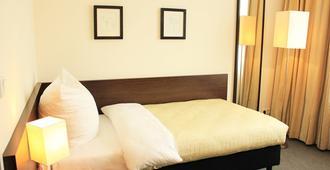 吕措酒店 - 柏林 - 睡房