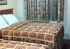 长滩陶尔汽车旅馆 - 长滩 - 睡房