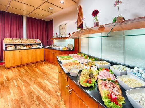 慕尼黑莱昂纳多酒店&公寓 - 慕尼黑 - 自助餐