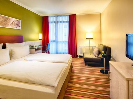 慕尼黑莱昂纳多酒店&公寓 - 慕尼黑 - 睡房