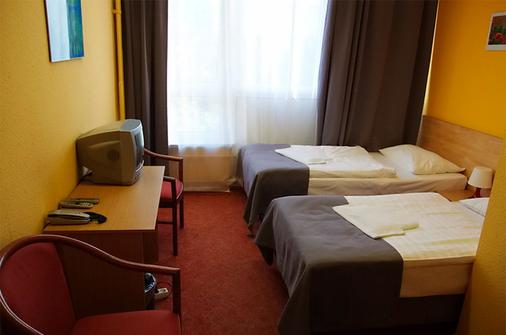 阿克图姆城市酒店 - 柏林 - 睡房