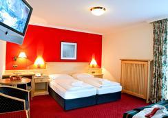 Kur- Und Sporthotel Alpina - Hotel Alpina - 巴特霍夫加施泰因 - 睡房
