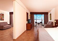桑多思帕帕加约海滩度假村-24小时 - 普拉亚布兰卡 - 睡房