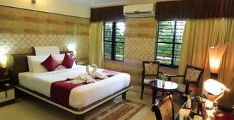 迈索尔加马哈度假村及水疗中心 - 迈索尔 - 睡房