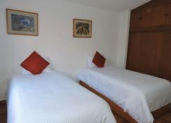 科约阿坎村舍酒店 - 墨西哥城 - 睡房