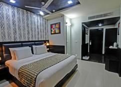 普里阿南亞榮譽度假村 - 普里 - 睡房