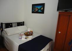 莎贝耶酒店 - Bogotá - 睡房