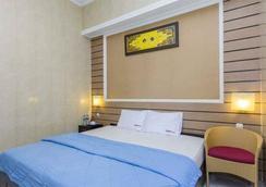 登纳伊斯酒店 - 乌鲁瓦图 - 睡房