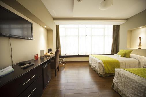 华美达酒店 - 瓜亚基尔 - 睡房