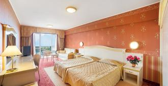 马杰斯迪克帕拉斯酒店 - 马尔切西内 - 睡房