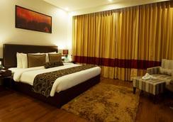 谦虚酒店 - 阿姆利则 - 睡房