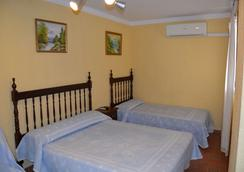 吉拉迪拉膳食酒店 - 塞维利亚 - 睡房