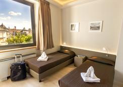 佛罗伦萨普鲁斯酒店 - 佛罗伦萨 - 睡房