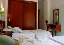 太阳假日酒店 - 拉克鲁斯 - 睡房
