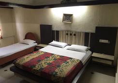 拉吉旅居酒店 - 金奈 - 睡房