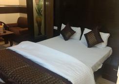 Hotel Sun Village - 新德里 - 睡房