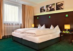 慕尼黑施瓦宾格弗莱明酒店 - 慕尼黑 - 睡房