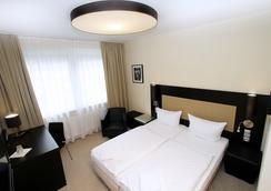卡尔门酒店 - 卡尔斯鲁厄 - 睡房