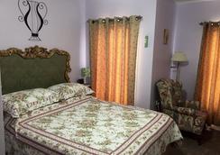 始终如一住宿加早餐酒店 - 尼亚加拉瀑布 - 睡房