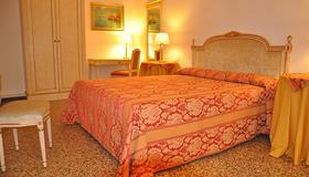 卡布拉加丁卡拉巴酒店 - 威尼斯 - 睡房