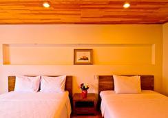 晃禄酒店 - Dalat - 睡房