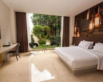 班达拉雅加达机场FM7度假村酒店 - 当格浪 - 睡房