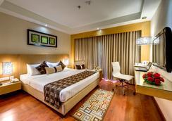 詹姆森西拉酒店 - 加尔各答 - 睡房