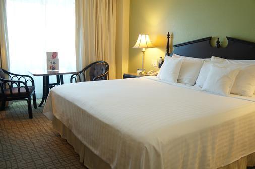 巴塞罗马拿瓜酒店 - 馬拿瓜 - 睡房