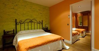 卡彼托利纳公寓式酒店 - 梅里达 - 睡房